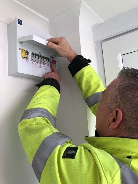 Emergency electrician fixing a fuseboard, ashford kent